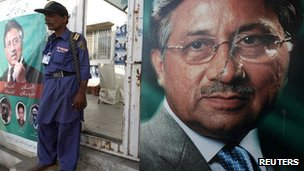 "A security man stands guard at the entrance of former president Pervez Musharraf""s campaign office"