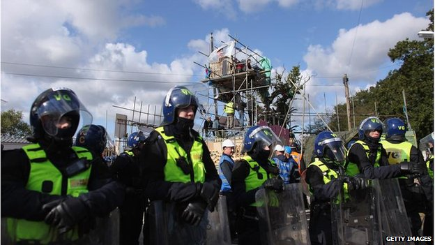 Police officers and bailiffs surround the main barricade during the eviction of Dale Farm travellers camp on October 19, 2011