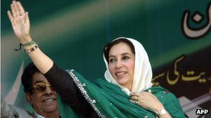 Benazir Bhutto  waving to supporters in 2007