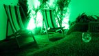 Grass room with green light deckchairs and whisky