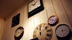 Clocks in wooden room