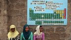 Female students sit under the periodic table of the elements in  Addis Ababa, Ethiopia, on 19 March 2013