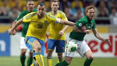 Zlatan Ibrahimovic battles with Paul Green in Stockholm