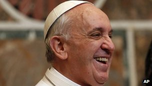Pope Francis smiles during an audience with ambassadors from the 180 countries that have diplomatic relations with the Holy See, at the Vatican, 22 March 2013