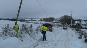 BT workers carrying out emergency repairs