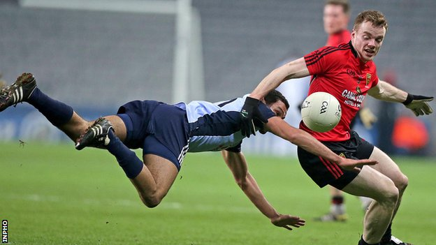 Dublin's Craig Dyas with a flying tackle on Brendan McArdle