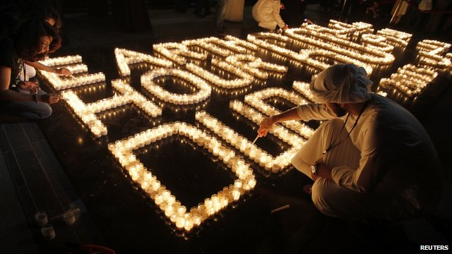 Emiratis light candles to mark Earth Hour near Burj Khalifa in Dubai