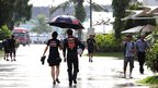 Daniel Ricciardo (19) is escorted back from a media session by Toro Rosso's press officer.