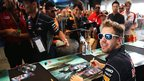 Sebastian Vettel signs autographs for fans