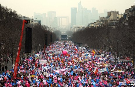 Protesters against gay marriage and adoption file down the Grande-Armee avenue in Paris, 24 March