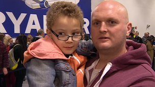 Rob Potts with his son at East Midlands Airport