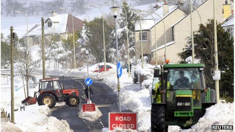 Tractors clear roads of snow in Northern Ireland