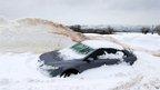 Car buried in snow in hills near Belfast