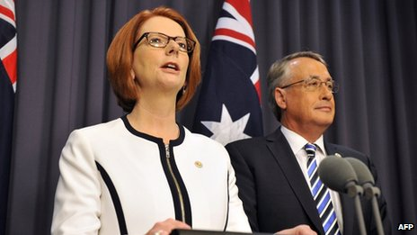 Julia Gillard (L) with Deputy Prime Minister Wayne Swan (R) in Canberra on 21 March 2013