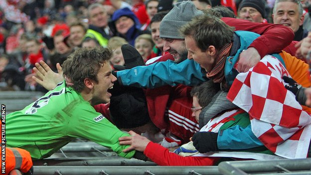 Wrexham goalkeeper Chris Maxwell celebrates with fans