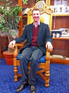 Mark in the headmaster's chair