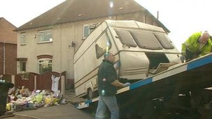 Caravan being taken from house for forensic examinations