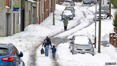 People walking on snowy road in N belfast