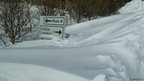 Isle of Man road sign after heavy snow in March 2013