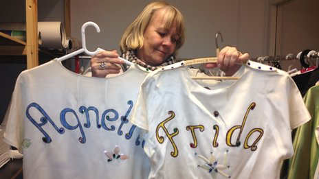 Museum curator Ingmarie Halling with outfits worn by Agnetha Faltskog and Frida Lyngstad