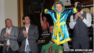 Oscar Knox in boxing robes.