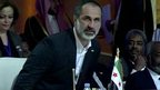 Opposition takes Syria summit seat