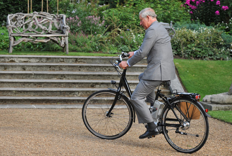 Prince Charles tries out an electric bike