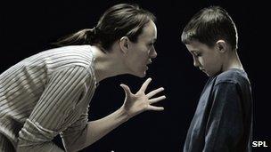 Mum telling off son