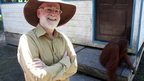 Terry Pratchett with an orangutan in Borneo