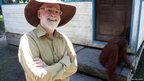Author Terry Pratchett revisits the orangutans of Borneo