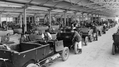 Staff working on a row of cars