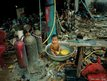A young child plays in his bath in a slum in Andong