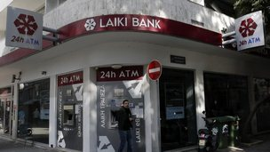 A man leaves a Laiki Bank ATM in Nicosia