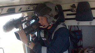 Cameraman in helicopter