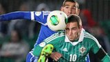 Eitan Tibi challenges Northern Ireland striker Martin Paterson