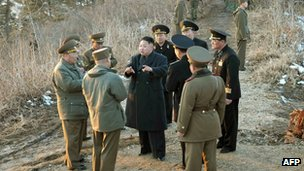 North Korean leader Kim Jong-un (C) speaks to military officials as he inspects a military unit on 25 March, in image released by KCNA news agency on 26 March 2013