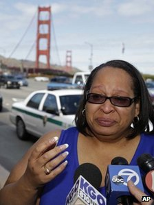 Toll-taker Jacquie Dean talks to reporters about her last day on the job at the Golden Gate Bridge on Tuesday