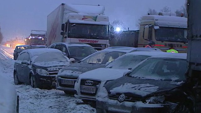 Lorries and cars on snowy road