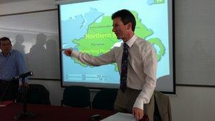 Mark Devenport addressing delegates at conference in Bogota
