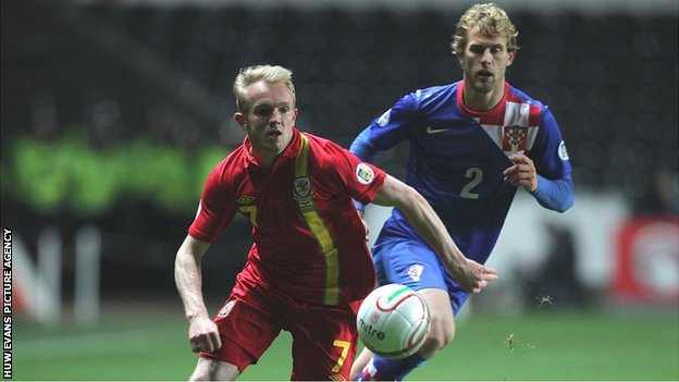 Wales' Jonathan Williams gets away from Croatia's Ivan Strinic