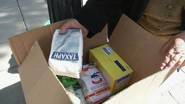Woman with goods from food banks