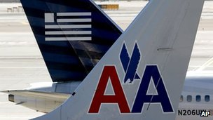 American Airlines and US Airways tail fins