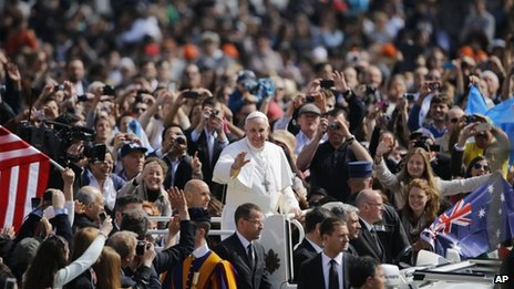 Pope Francis is driven through the crowd during his first general audience in St Peter's Square at the Vatican on Wednesday
