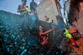 A boy sprays coloured foam during Holi