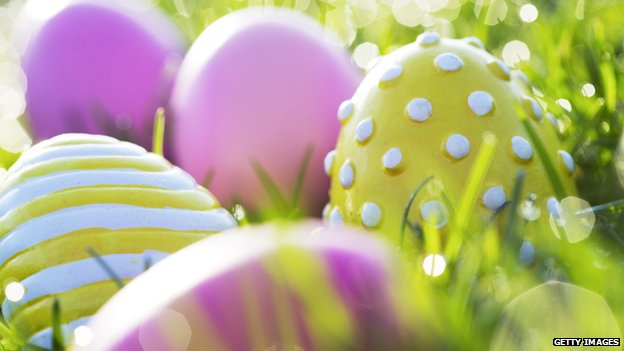 Colourful Easter eggs in a field