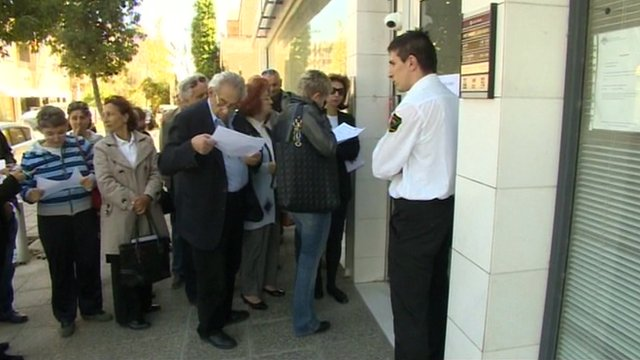 Customers at a Cypriot bank
