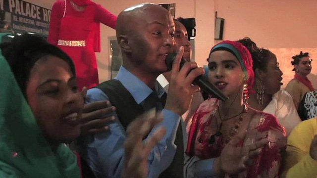 Men and women singing and dancing during a concert in Mogadishu