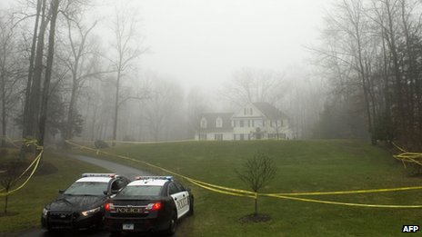 Police outside the home of Nancy Lanza in Newtown, Connecticut on 18 December 2012