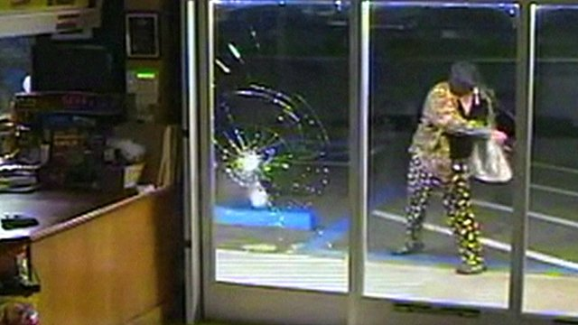 Man tries to smash a window