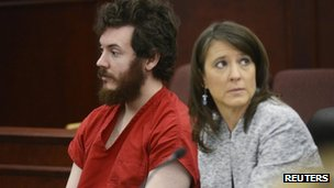Accused Aurora theater shooting suspect James Holmes listens with public defender Tamara Brady at his arraignment in Centennial, Colorado 12 March 2013